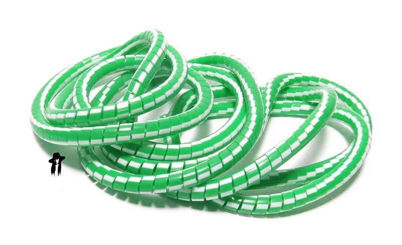 GREEN & WHITE plastic cable or wire cover